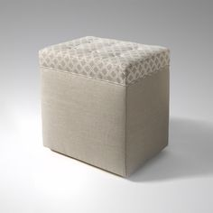The Nantucket Knots Ottoman from Waterworks has a palette of warm hues and repeat geometric pattern. The textually rich fabric is perfect for any room.