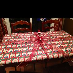 Elf on a Shelf - Antic: Wrapped the kitchen table up like a giant present