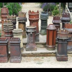 A quantity of glazed terracotta chimney pots,