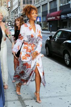 """30+ Outfits That Prove Rihanna's DGAF Style Has Always Slayed  #refinery29  http://www.refinery29.com/2016/03/106350/rihanna-street-style-photos#slide-15  We're calling this the """"robe-and-go.""""..."""