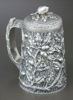 Kirk & Son coin silver fine) repoussé covered tankard, with acorn and oak leaf motif, branch form handle and figural acorn finial - Baltimore, (Heritage Auctions). Vintage Silver, Antique Silver, Acorn And Oak, Mighty Oaks, Bronze, Vintage Items, Auction, Amazing, Sterling Silver