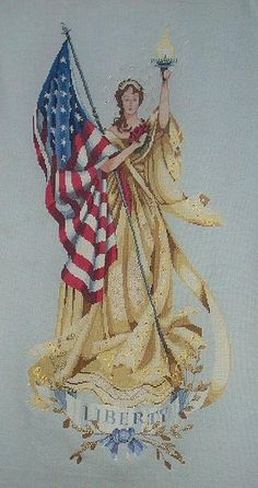 "Mirabilia ""Lady of the Flag"" patriotic cross stitch"
