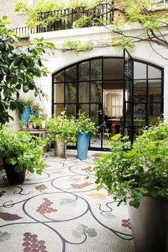 Mosaic, from kitchen to courtyard. As featured in House and Garden magazine.