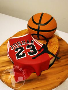 Air Jordan Cake. This cake is all edible. The basketball is Rice Krispies treats. All other decorations are fondant. The wooden court is hand painted fondant.