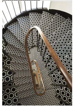stunning black and white tile stairwell.