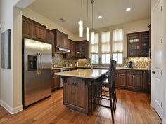 Kitchen | Modern | Glass Tile | Granite | Pendent Lights | Dark Cabinets | Elevated Ceilings | Wood Floors | Mueller Homes Austin Texas | Mueller Realtor | Mueller Development | 2033 McCloskey St, www.muellersilentmarket.com