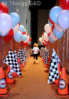 Awesome entryway !!!!  Orange road cones & checkered flags   Race / motorcycle birthday party