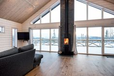 Stort fönsterparti med kamin i mitten Narrow House Designs, House Extension Design, Attic House, Cabin Design, Living Room With Fireplace, Scandinavian Home, House Floor Plans, Home Remodeling, Interior Design
