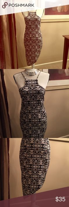 Express Body Con Dress Figure flattering and extremely sexy spaghetti strap dress. Asymmetrical hemline adds flair and fun to this very stylish jersey Knit dress. It will certainly be a favorite of yours. Worn once or twice so it's in excellent condition. Express Dresses Asymmetrical