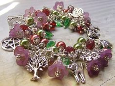Pagan Goddess Charm Bracelet  HEDGEWITCH  by Ravenshire's Realm ... A Hedge Witch is a solitary practitioner of Wicca - A Wise woman understanding nature, prophecy and divination, as well as magick and healing. They served their community in many ways - midwifery, healing, protection spells, house blessings, crop and livestock blessings. Her craft is her own - usually handed down to her by family and honed by her own experience and research.