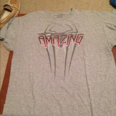 Amazing Spiderman tee shirt! I got this by buying the biggest bucket of popcorn one could possibly buy from the movie theater when this movie first came out! It's a really cool shirt to own if you a spiderman fan! It has no holes or stains! It comes from a smoke free environment! I don't hold or trade! I ship Monday-Friday! Please don't negotiate the price in the comments! Hot Topic Tops Tees - Short Sleeve