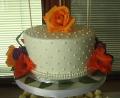 A pretty buttercream-covered wedding cake with fresh flowers. So summery!