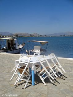 Faros waterfront taverna in a small village on the opposite coast of the Argolic Gulf facing - Greece, Coast, Light House, Grease