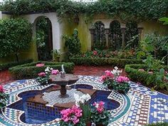 A beautiful mosaic tiled fountain at a moroccan mosaic for Moroccan style garden ideas