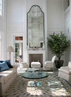 Bruce Bierman: This two-storied Palm Beach living room has a 25-foot-high ceiling. At Lorin Marsh in New York I found an antique Venetian mirror that was perfect to hang over the fireplace, but it was only four foot tall. So I had a 10-foot-tall version of it replicated in Italy, and the reworked proportions fit the space perfectly.
