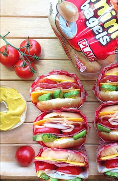 Little bites loaded with big flavor, these sandwiches are one easy snack: turkey, salami, avocado and tomato on top of Thomas' Mini Bagels.