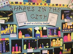 Students created a city using geometric shapes they cut free hand.