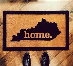 """Durable and stylish, this door mat features an imprint of your state with our popular home. logo, from our Original Home Shirt. Both functional and welcoming, it's perfect for an entryway, front porch or deck! Our mats make a wonderful wedding, housewarming, or holiday gift; your family and friends are guaranteed to adore this extraordinary addition to their """"home!"""""""