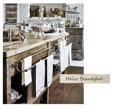 tone of wood on island, towel bars near sink