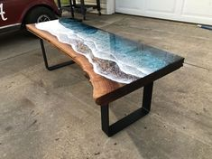 Artist Rivka Wilkins and woodworker Jared Davis have collaborated on a series of beautiful coffee tables that capture ocean waves crashing on the shores of a…