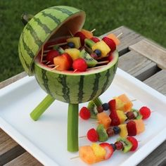 Make a watermelon centerpiece that's functional and edible. Add some fruit kabobs and you've got a BBQ grill that will thrill.