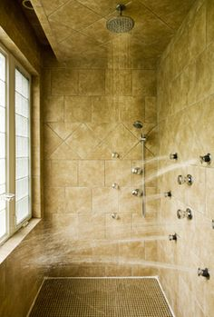 Multi head shower, note ceiling rainhead