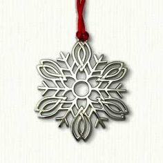 """Celtic Snowflake Ornament Size: 2 3/4"""" x 2 3/4"""" Cost: $14.95 Velveteen pouch included"""
