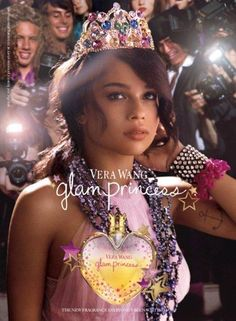 - aimed at a younger audience? heart shaped bottle, tacky crown and jewellery, paparazzi in the background she is the star, stars around the bottle like it is shining, model gazing into the distance, anchor tattoo on the model is she meant to be seen as a bit rebellious? -