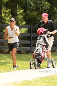Photo Gallery: Former Arkansas and Louisville football coach Bobby Petrino caddied for his daughter, Katie Petrino, during the Lexmark Kentucky Women's Open in Nicholasville www.kentucky.com/2012/07/17/2261534/kentucky-womens-open.html
