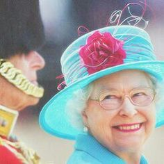 Queen Elizabeth II giving a most wonderful smile to her husband, Prince Phillip. :)