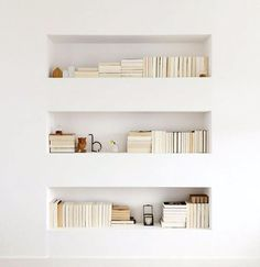 built-in plaster shelving with book storage / sfgirlbybay