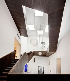 A boxy wooden staircase twists up through the floors of this design store inShanghai byarchitectsNeri.