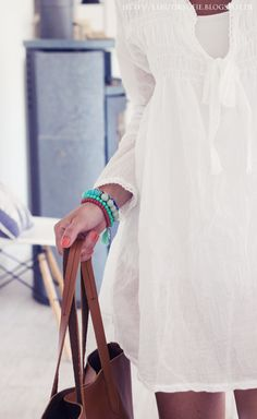 butiksofie. White linen dress with turquoise and brown leather.