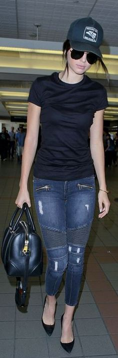 Who made  Kendall Jenner's black hat, aviator sunglasses, skinny blue zipper jeans, and black suede pumps?