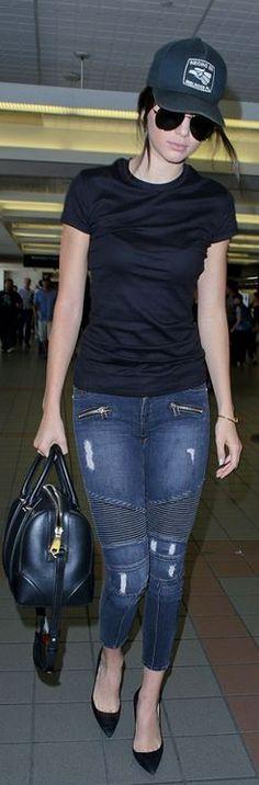 Kendall Jenner: Hat – Goorin Bros.  Purse – Givenchy  Bracelet – Cartier  Jeans – Lovers + Friends  Sunglasses – Saint Laurent