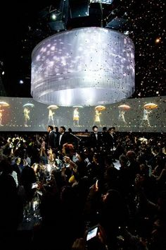 Burberry World Live in Taipei. Guests were invited to step inside the brand's world, with a 360 degree cylindrical space combining film, live music and interactive, simulated British weather. Leaves fell from the ceiling, followed by golden rain. What an amazing immersive brand experience.