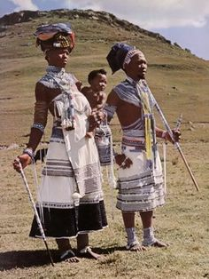 "Thembu couple and child wearing complete beadwork outfits. Image taken from the publication ""Red Blanket Valley"" by Joan Broster."