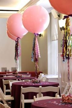 pink geronimo balloons as centerpieces at wedding reception @myweddingdotcom