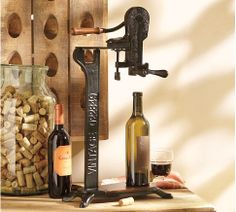 "Founders Standing Wine Opener  $199.00    Founders Wine Opener is a vintner-approved adaptation of a professional cork pull. It's marked Vintage 022849 – the date of Pottery Barn's founding.  Standing Wine Opener, 14"" wide x 7"" deep x 25"" high   Iron construction over mango-wood base."