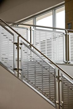 Silhouette Railing System with Stainless Steel guardrail, handrail and custom Stainless Steel screen infill at Logan College of Chiropractic, Chesterfield, Missouri Steel Railing Design, Staircase Railing Design, Balcony Railing Design, Stainless Steel Handrail, Stainless Steel Screen, Outdoor Handrail, Rustic Bathroom Designs, Modern Bathroom, Steel Stairs
