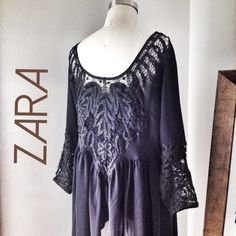 ZARA Boho Lace Black Tunic Top Pretty boho Zara blouse with cotton lace details and drapey poly georgette Babydoll silhouette. Dolman sleeves. Size M, NWOT, never worn. Super cute with cutoff shorts or distressed jeans. Zara Tops Tunics