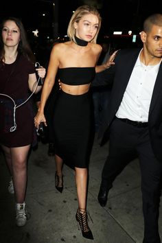 The model heads to Justin Bieber's AMAs after party at The Nice Guy Restaurant in Los Angeles in a choker, strapless bra top and pencil skirt.    - HarpersBAZAAR.com
