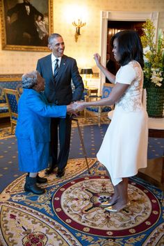 "Feb. 18, 2016 ""President Obama watches the First Lady dance with 106-year-old Virginia McLaurin in the Blue Room of the White House prior to a reception celebrating African American History Month."" (Official White House Photo by Pete Souza)"