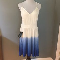 Bebe Ombré Dresss Bebe high, low ombré dress blue and white dress with open back. States small, fits medium. Length is 40 inches in the front and 49 in the back. Bebe Dresses