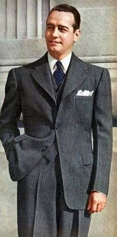 1940s men's suit fashion - 1943 Single Breasted Grey Suit. Notice the three fold pocket sqaure. .