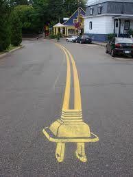 Roadsworth street art.