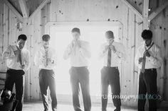groom and groomsmen getting ready putting on ties black and white rustic romantic chic wedding  http://www.trueimageryblog.blogspot.com/