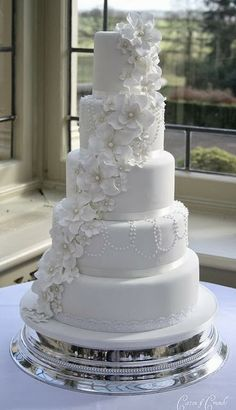 wedding cake, maybe add a few small purple and grey flowers