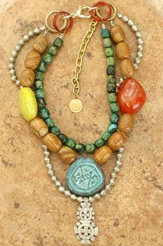 Bohemia: This vibrant bohemian tribal statement necklace is a unique fusion of ancient and modern components with an overall earthy tone. Saturated hues of blue