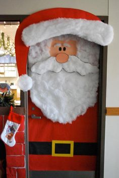 Santa door display... This is adorable!  The fire marhsall would probably have a cow, though.